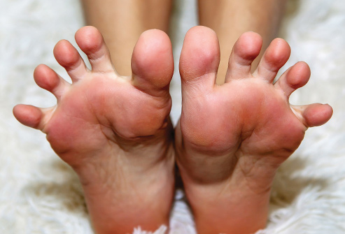 493ss_thinkstock_rf_woman_stretching_feet