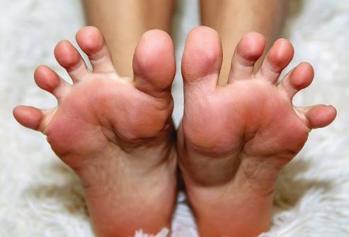 493ss_thinkstock_rf_woman_stretching_feet